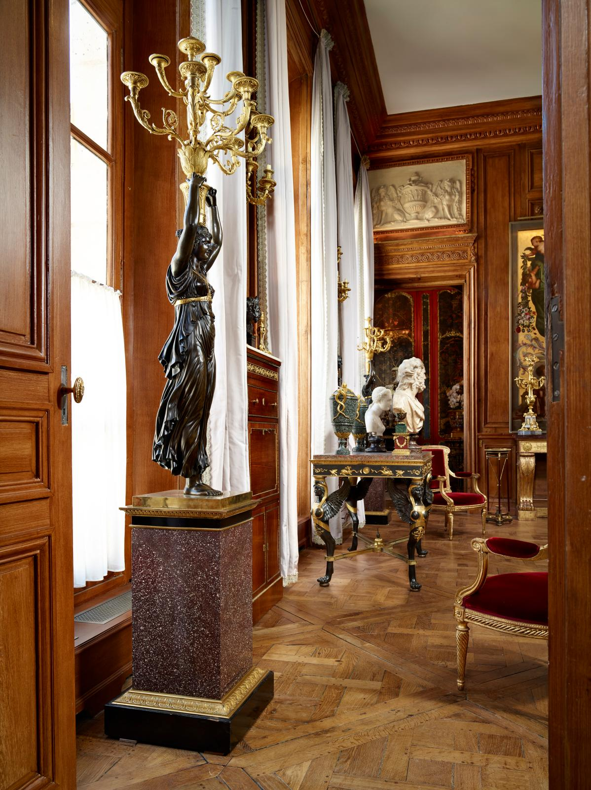 In the Louis XVI Grand Salon, two of Thomire's creations: the large candelabra from the Demidoff collections, and the winged sphinx table from the Rot