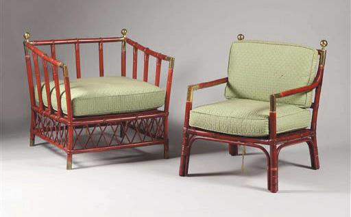 2 772 €. Salon de jardin d'hiver comprenant deux canapés, une paire de fauteuils et deux bergères, vers 1960, osier laqué rouge, boules et ornières en