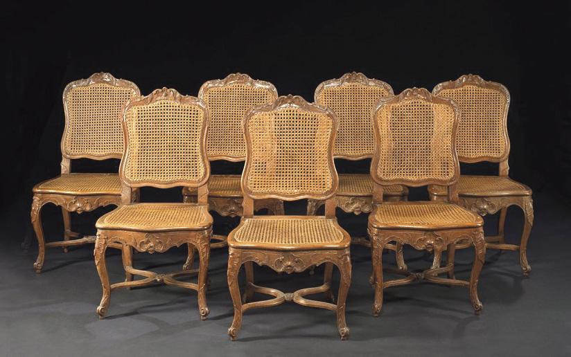 9000€ Pierre Nogaret(1718-1771), suite de sept chaises «à la coquille» en hêtre et à fond de canne, entretoise en «X» et présentant une belle coqui