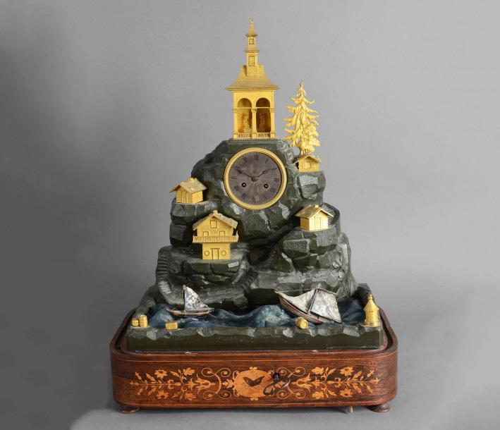 1245€ Époque Louis-Philippe(1830-1848). Pendule automate en bronze patiné et doré, figurant un paysage montagneux agrémenté de chalets, de sapins e