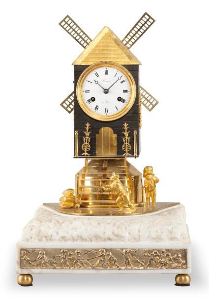 18835€ Début du XIXesiècle. Pendule à automate en bronze et marbre, au cadran signé «Frisard à Paris», ornée de deux meuniers s'affairant et aux ai