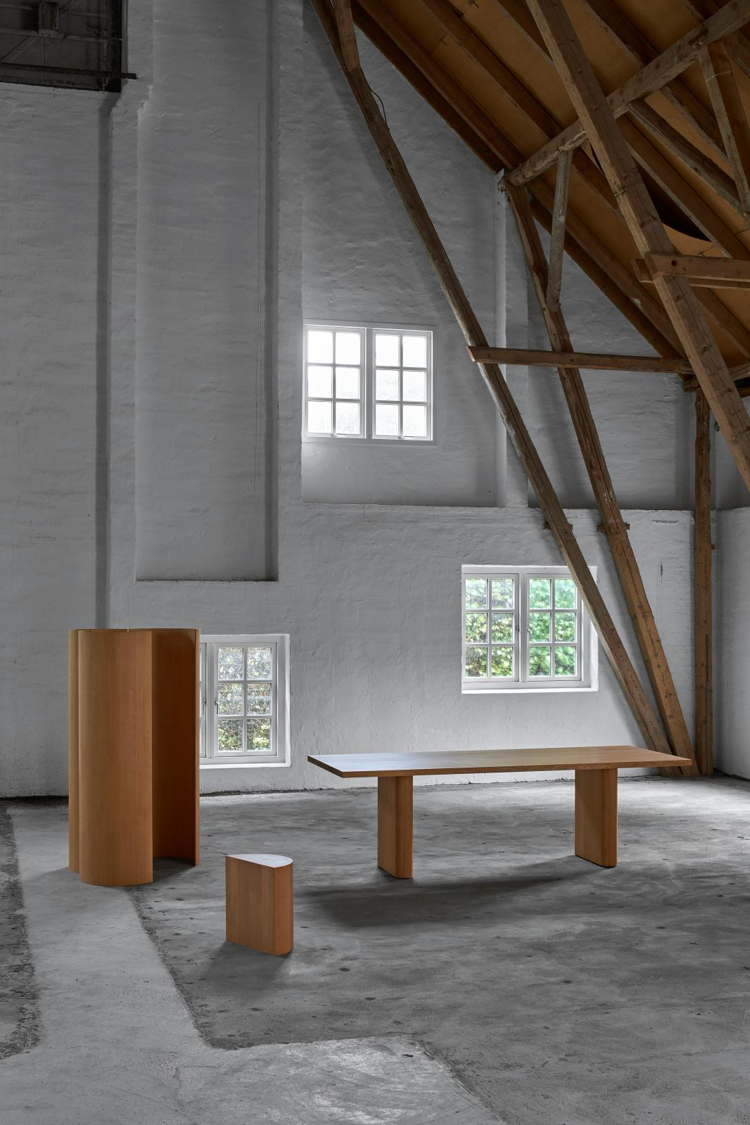 Halfway Round Collection (2018) by Michael Anastassiades for Dansk Møbelkunst: (left to right) screen, stool and dining room table, made in Oregon pin