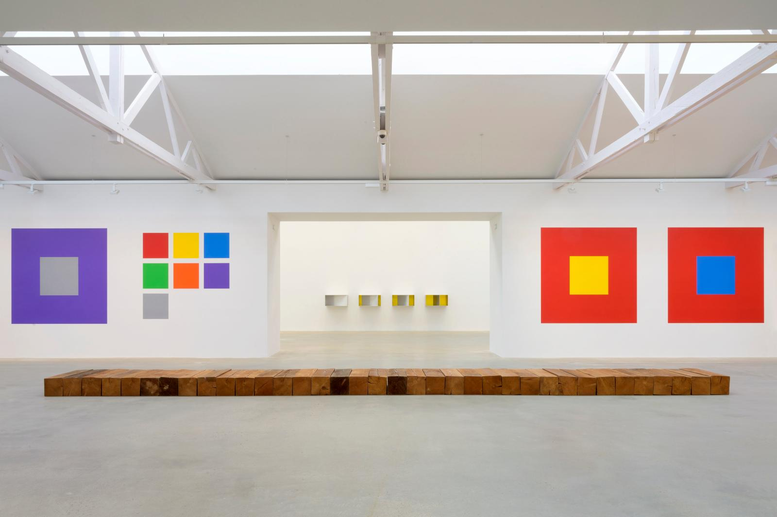 """BAR"" (1981) by Carl Andre, ""Wall Drawing #1176 Seven Basic Colors and All Their Combinations in a Square within a Square"" (2005) by Sol LeWitt and ""U"