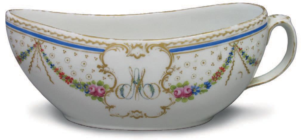 Bourdaloue en porcelaine, décor de guirlandes de fleurs polychromes, filet bleu et frises de feuilles or, les faces portent le monogramme MA dans un c
