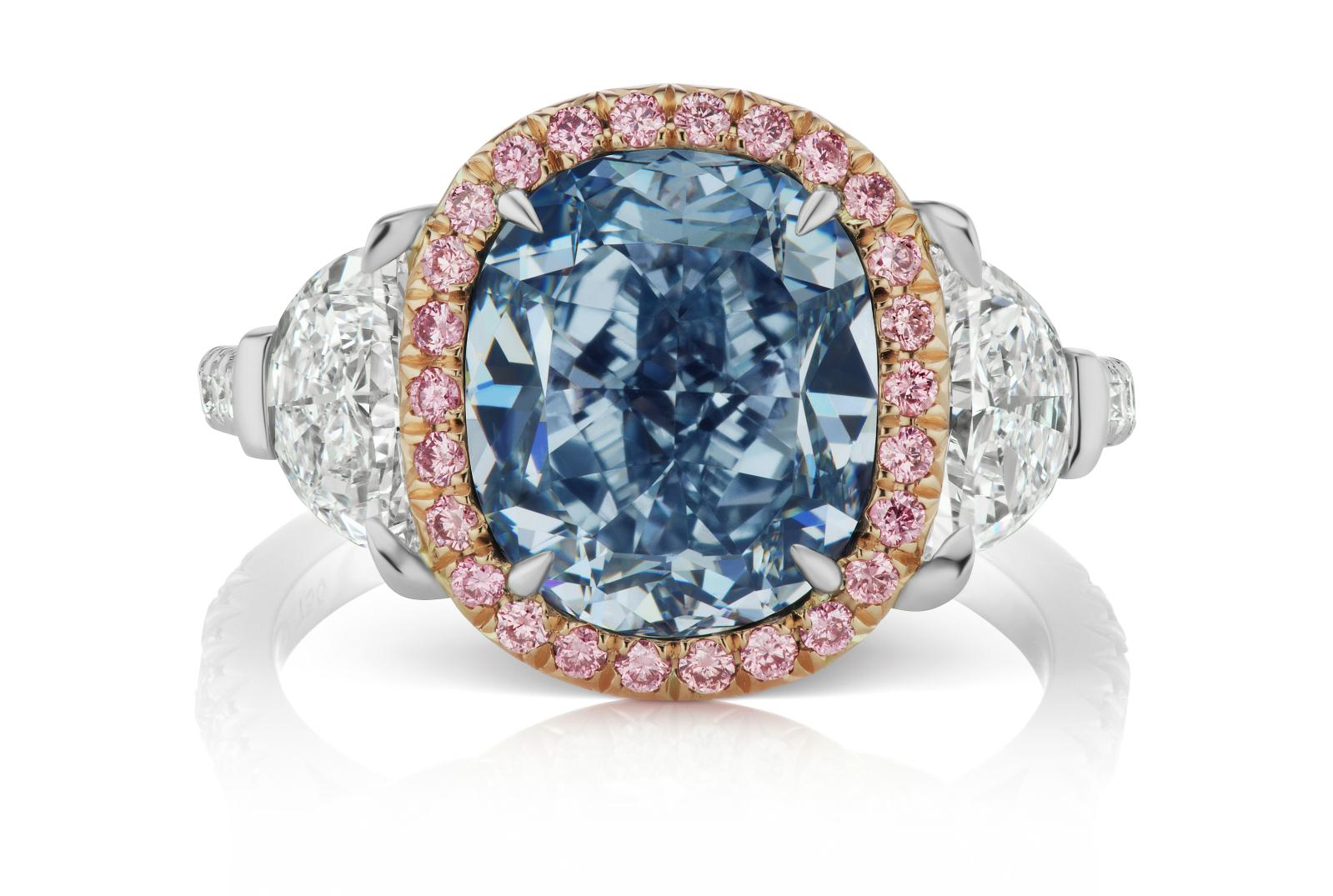 L. J. West, oval diamond ring, 3.04 ct, fancy intense blue VS2 colour, set with two half-moon diamonds surrounded by pink diamonds, presented last Apr