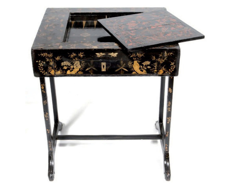 €682 Wooden gaming table, red and gold lacquer on a black background, the top concealing a backgammon board and a drawer, Anglo-Chinese taste, late 19