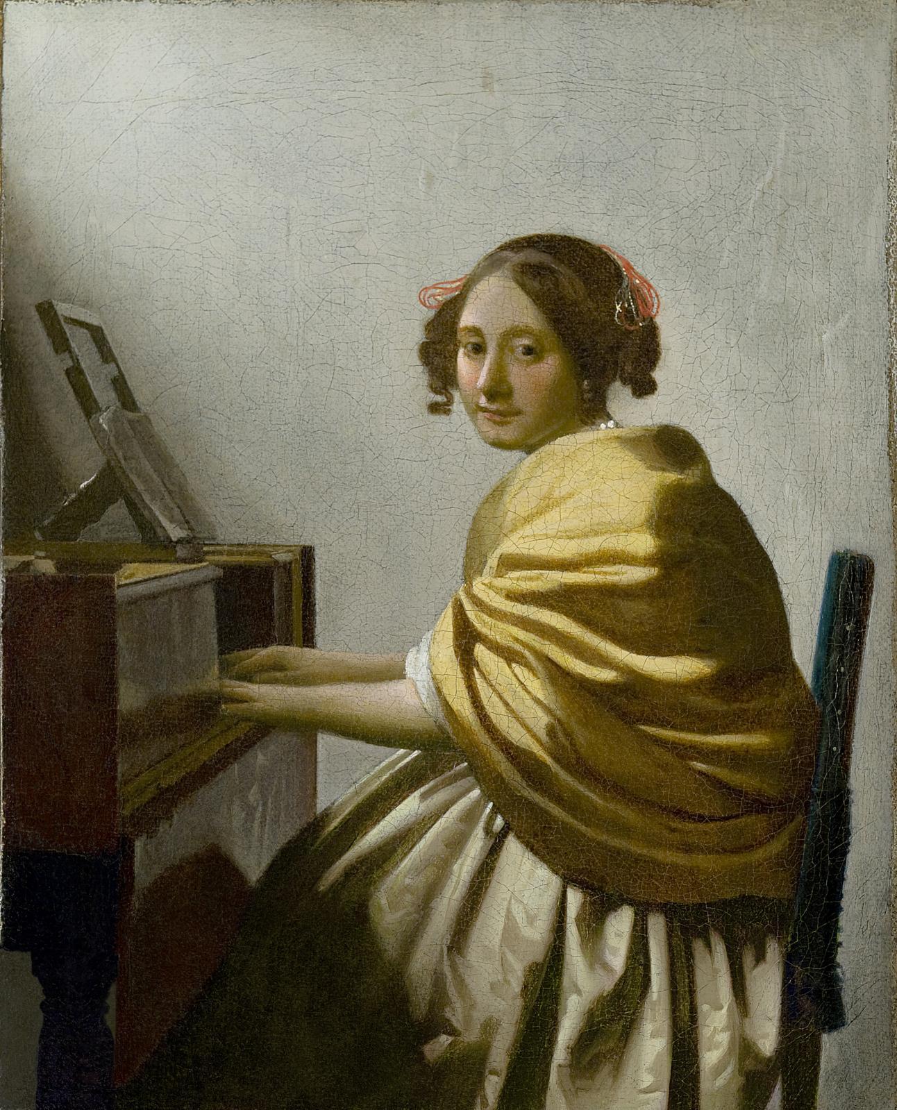 Johannes Vermeer,  Jeune femme assise au virginal, vers 1670-1672, huile sur toile, 25,5x20,1cm. © The Leiden Collection, New York.