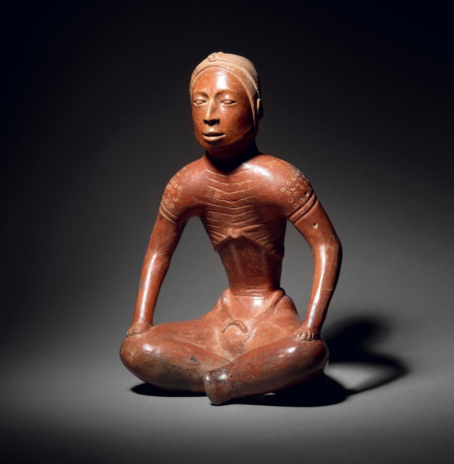 Colima culture, Western Mexico, proto-classic, 100 BC-250 AD, seated figure, ceramic with orange-brown slip, h. 33, l. 21 cm.Estimate: €30,000/35,000