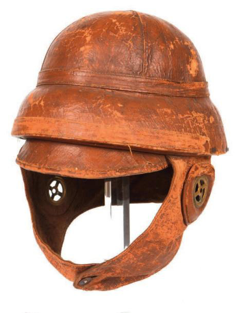 595€Casque d'aviateur «Roold», Première Guerre mondiale, en liège recouvert de toile brune, complet avec oreillettes, étiquette de tailleur datée191