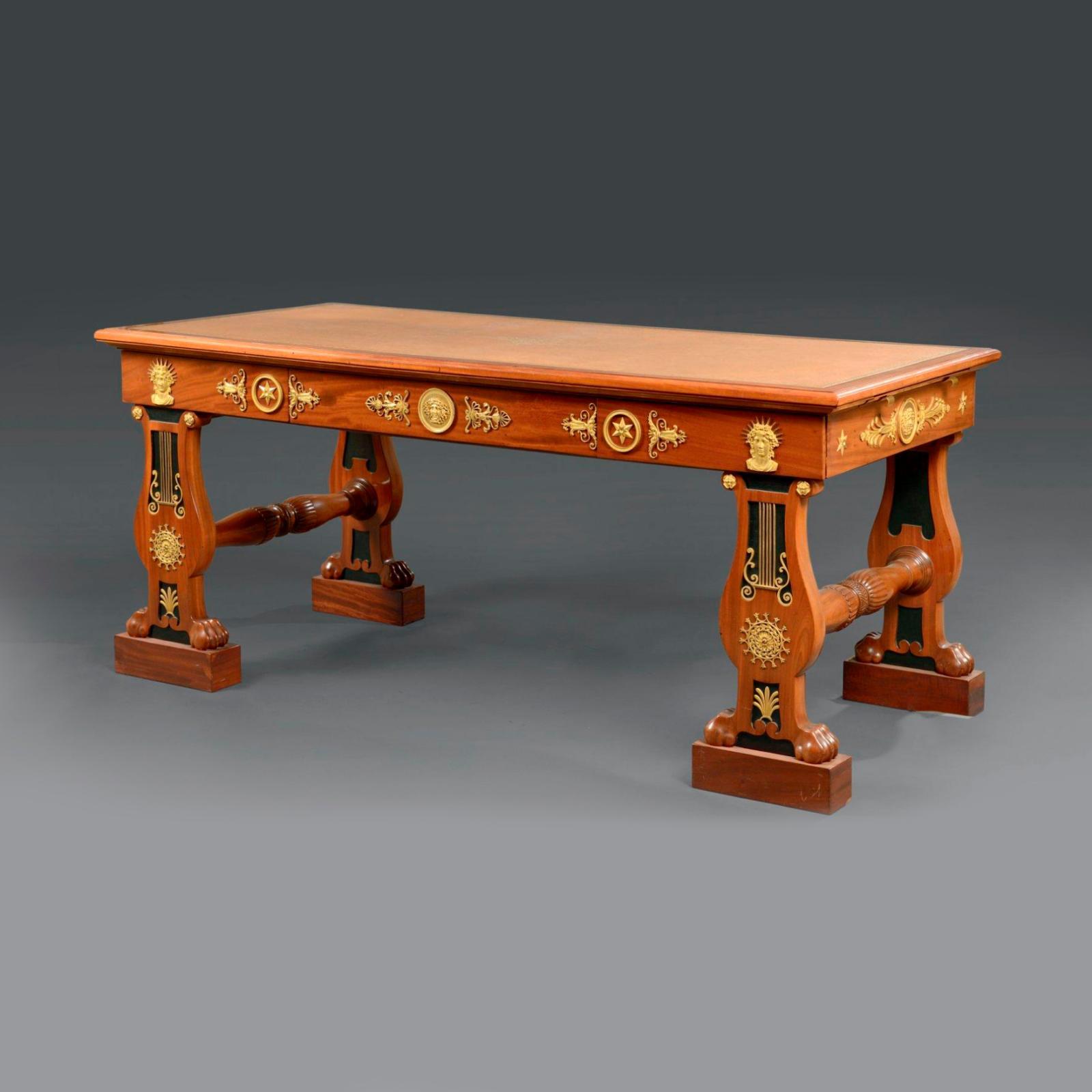 156250€ Attribué à F.-H.-G. Jacob-Desmalter. Grand bureau plat de Maréchal en bois et placage d'acajou, piétement à motifs de lyres, bronzes attribu