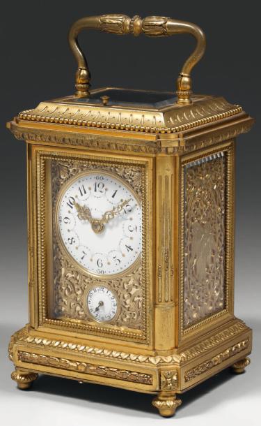 4957€Jean-Paul Garnier (1802-1869), pendule cage de voyage formant réveil, vers 1830-1840, bronze ciselé et doré, h. 20,5 cm. Drouot, 28 juin 2011.M