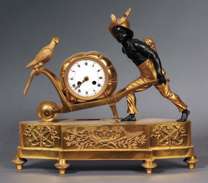 20 400 € frais compris.Pendule au nègre poussant une brouette, bronze ciselé doré et patiné, premier quart du XIXe siècle, 35 x 39 cm. Paris-Drouot, 3