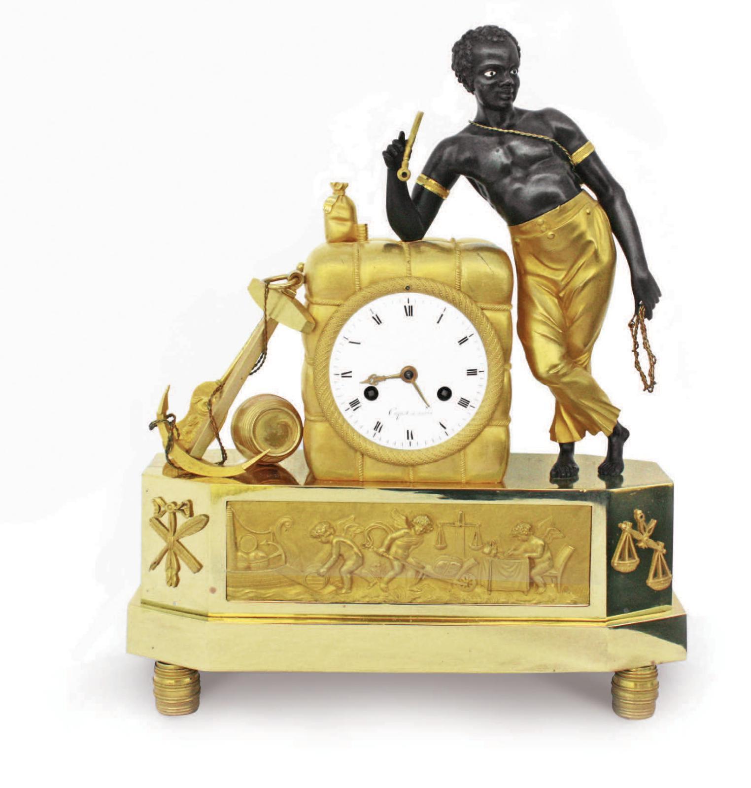 22 800 € frais compris.Pendule au matelot, bronze doré et patiné, cadran signé Coquet à Paris, début du XIXe siècle, h. 38 cm. Vannes, 28 juin 2008. J