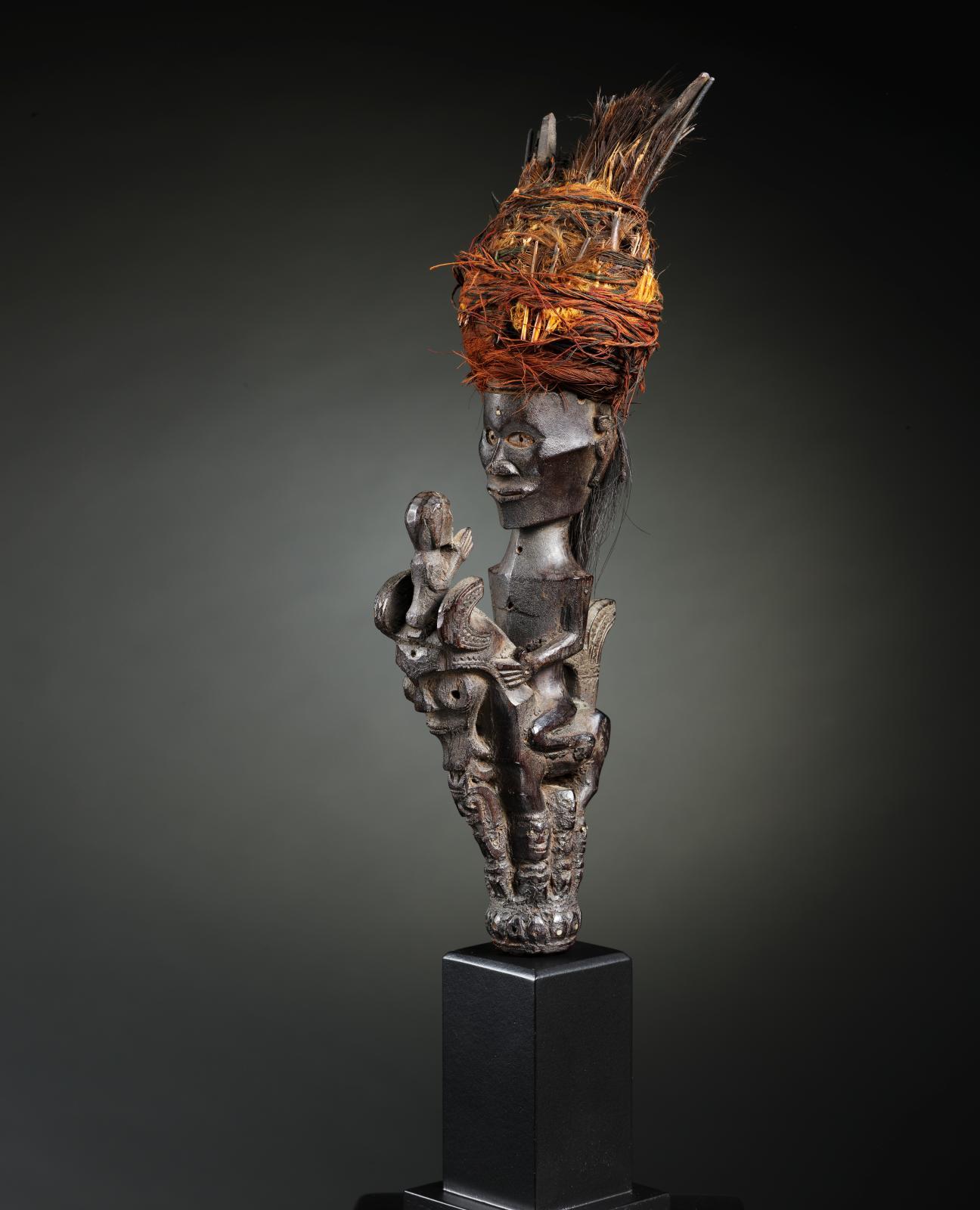Karo Batak, Sumatra, 18th-19th century, headpiece of a shaman's staff (tungkot malehat), wood, cotton, hair, feathers, h. 32.8 cm.Thomas Murray galle