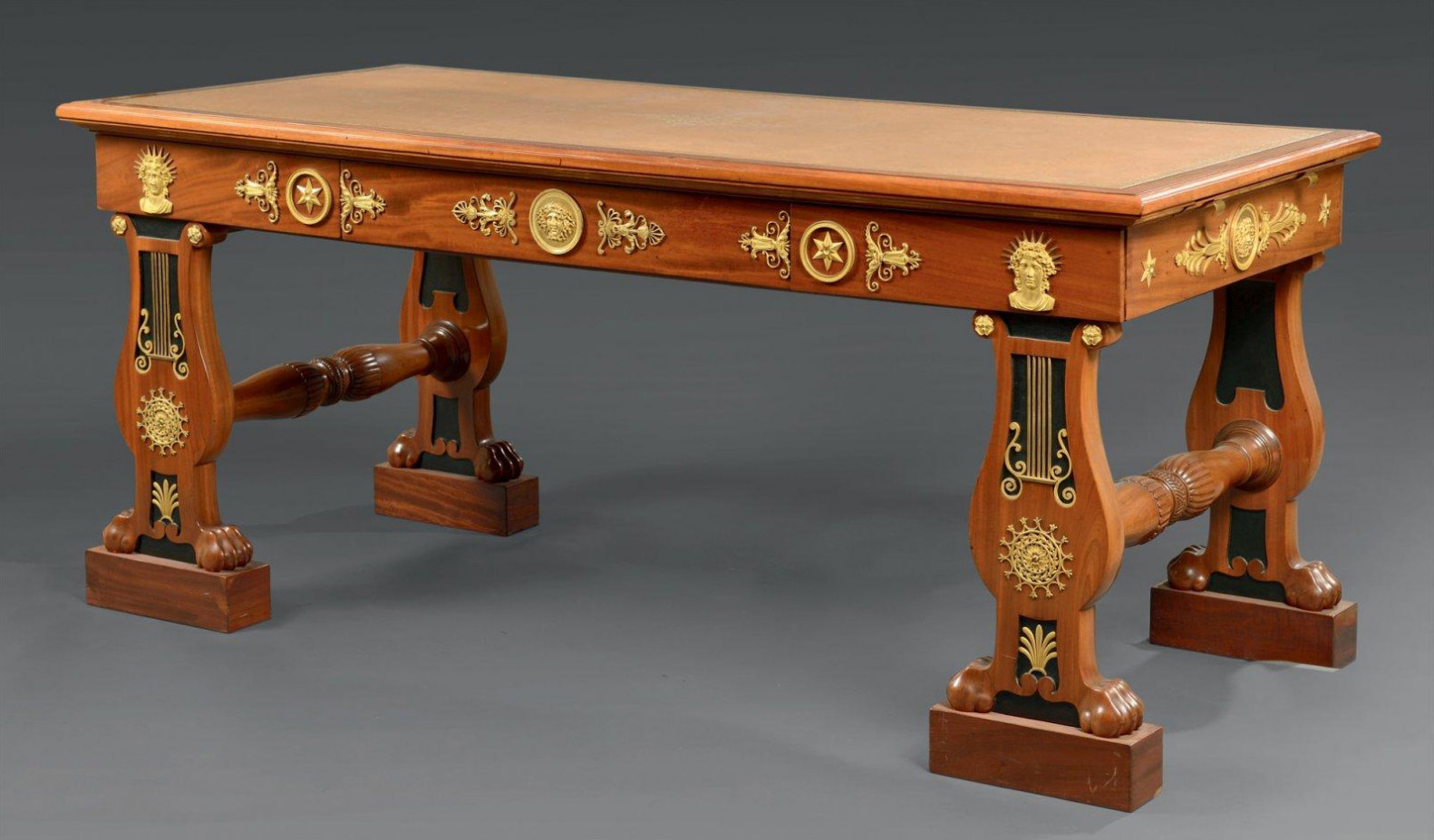 €156,250Attributed to F.-H.-G. Jacob-Desmalter, large Maréchal flat desk in mahogany wood and veneering, base with lyre motifs, bronze mou