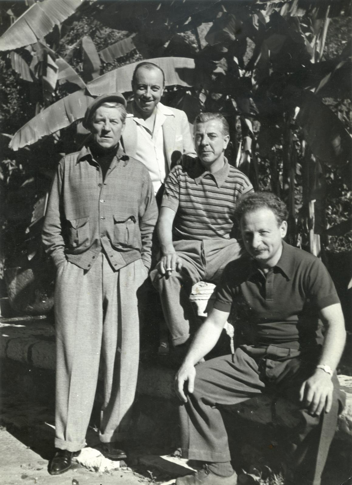 Émile Savitry (1903-1967), Jean Gabin, Marcel Carné, Jacques Prévert and Alexandre Trauner, in a garden, Saint-Paul-de-Vence, 1943, vintag