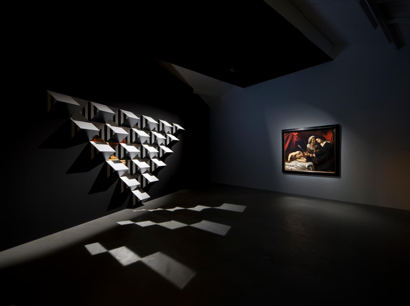 """Exhibition """"Caravaggio, Judith Beheading Holofernes – Daniel Buren, Pyramidal, Haut-Relief-AS, travail situ锩 daniel buren - adagp, paris"""