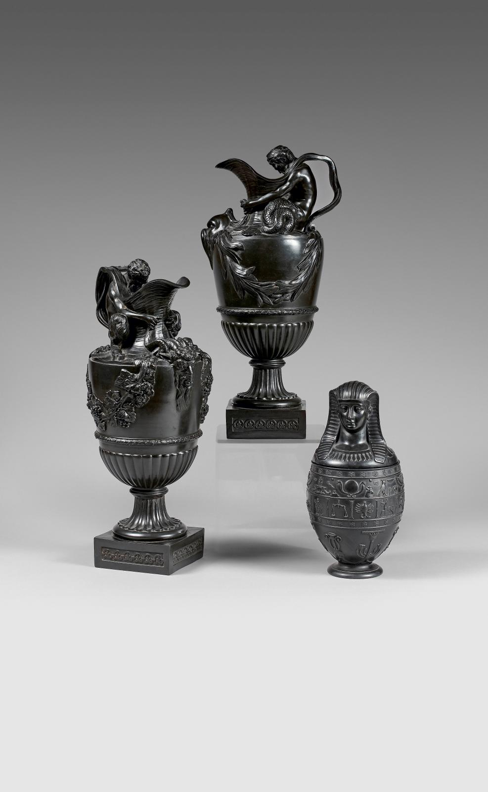 Late 18th century, Wedgwood, model after Sigisbert-François Michel (1728-1811), pair of black basalt ewers with handles in the form of sat