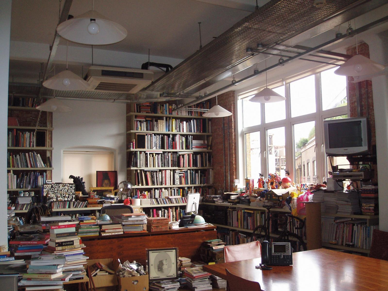 Paul Smith's office, cluttered with books and objects.© Paul Smith