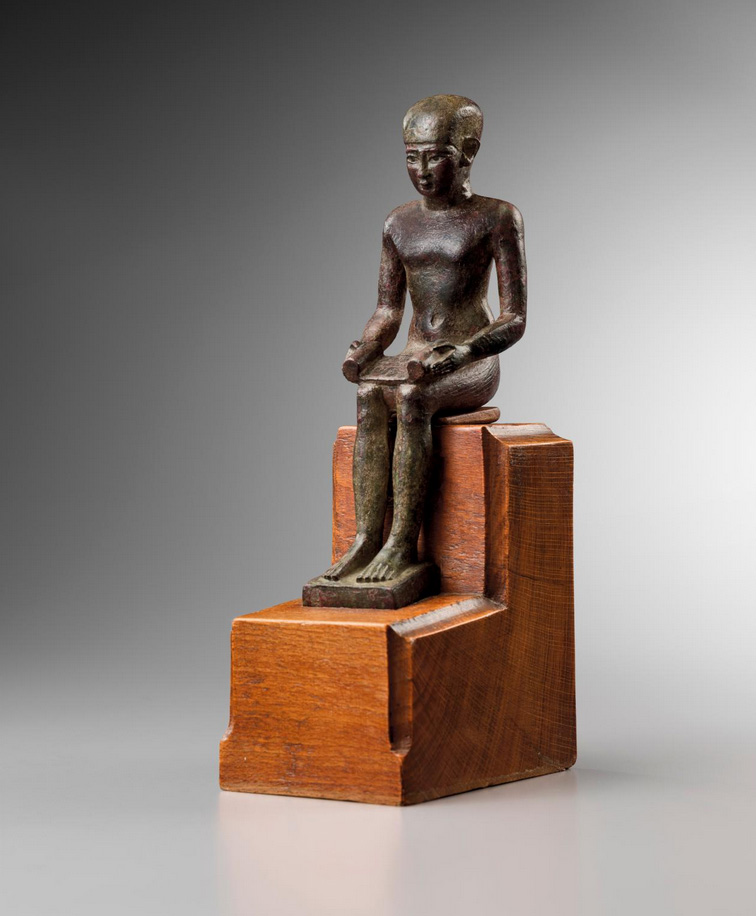 Egypt, Late Period, 7th century BC, statuette of Imhotep, bronze, h. 17 cm.Courtesy Grusenmeyer-Woliner Gallery, Brussels
