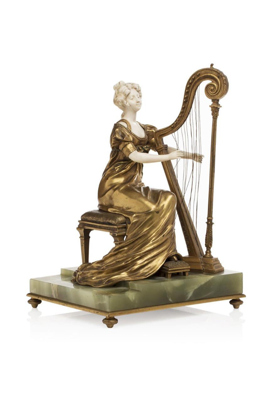 3640€ Jean Louis Grégoire(1840-1890), sculpture en bronze doré et ivoire, sur base en onyx vert, 36x24,5x20,5cm.Drouot, 30mars 20