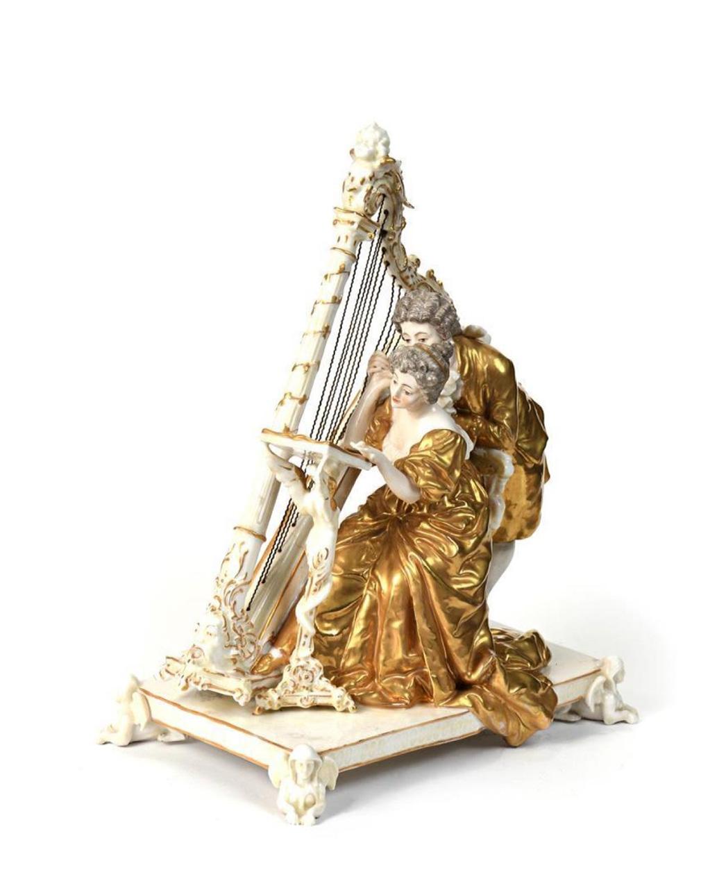 272€ Allemagne, vers 1900.La Leçon de harpe, porcelaine, 33x27x19cm.Tours, 16novembre 2019.Hôtel des ventes GiraudeauOVV.