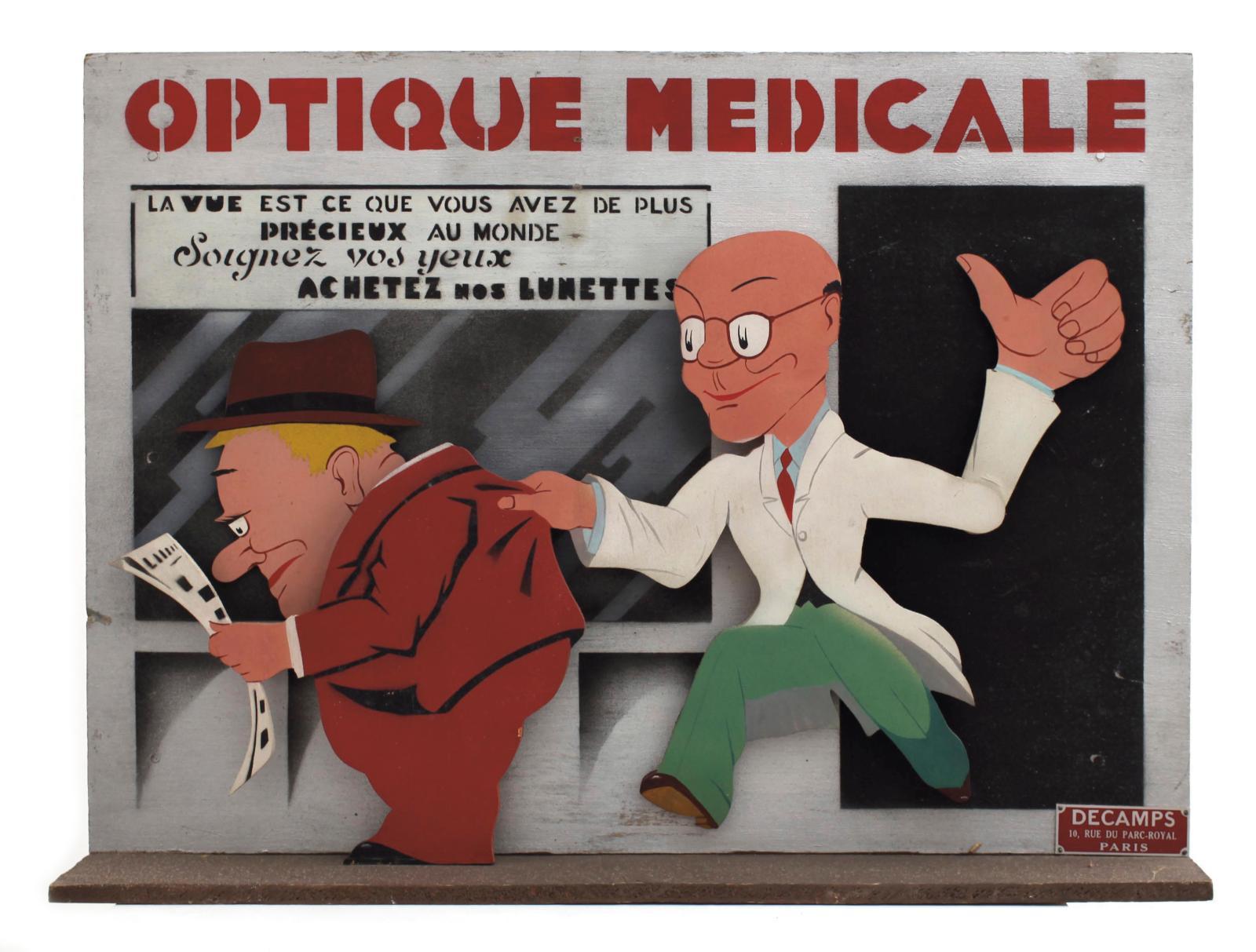 Decamps, Paris, années1930, Optique médicale, présentoir automate de vitrine en bois et métal découpé peint,mécanisme électrique 110volt