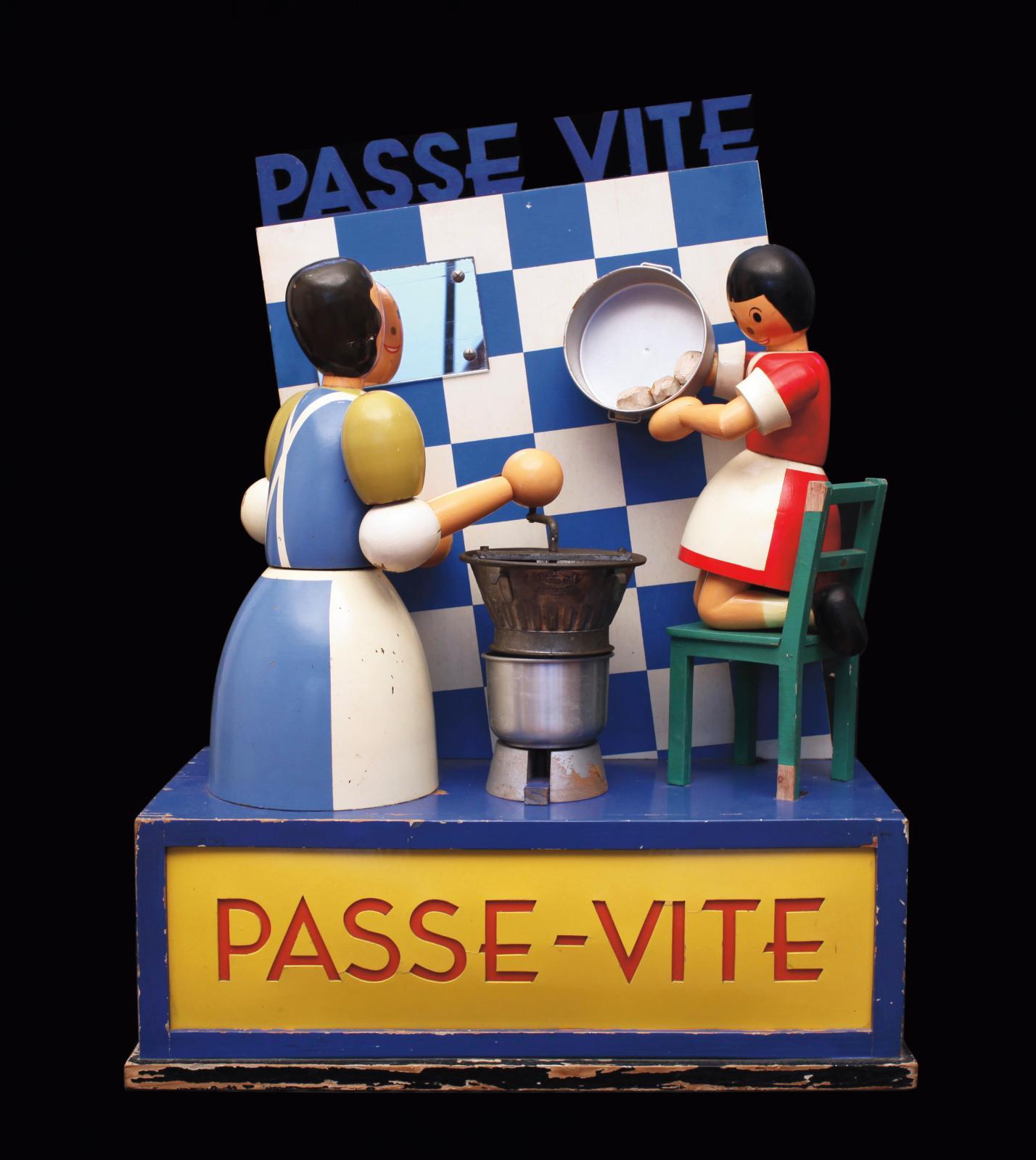 Betterway, Belgique, années1930. Passe-Vite, présentoir automate de vitrine en bois découpé peint, mécanisme électromécanique 110volts,