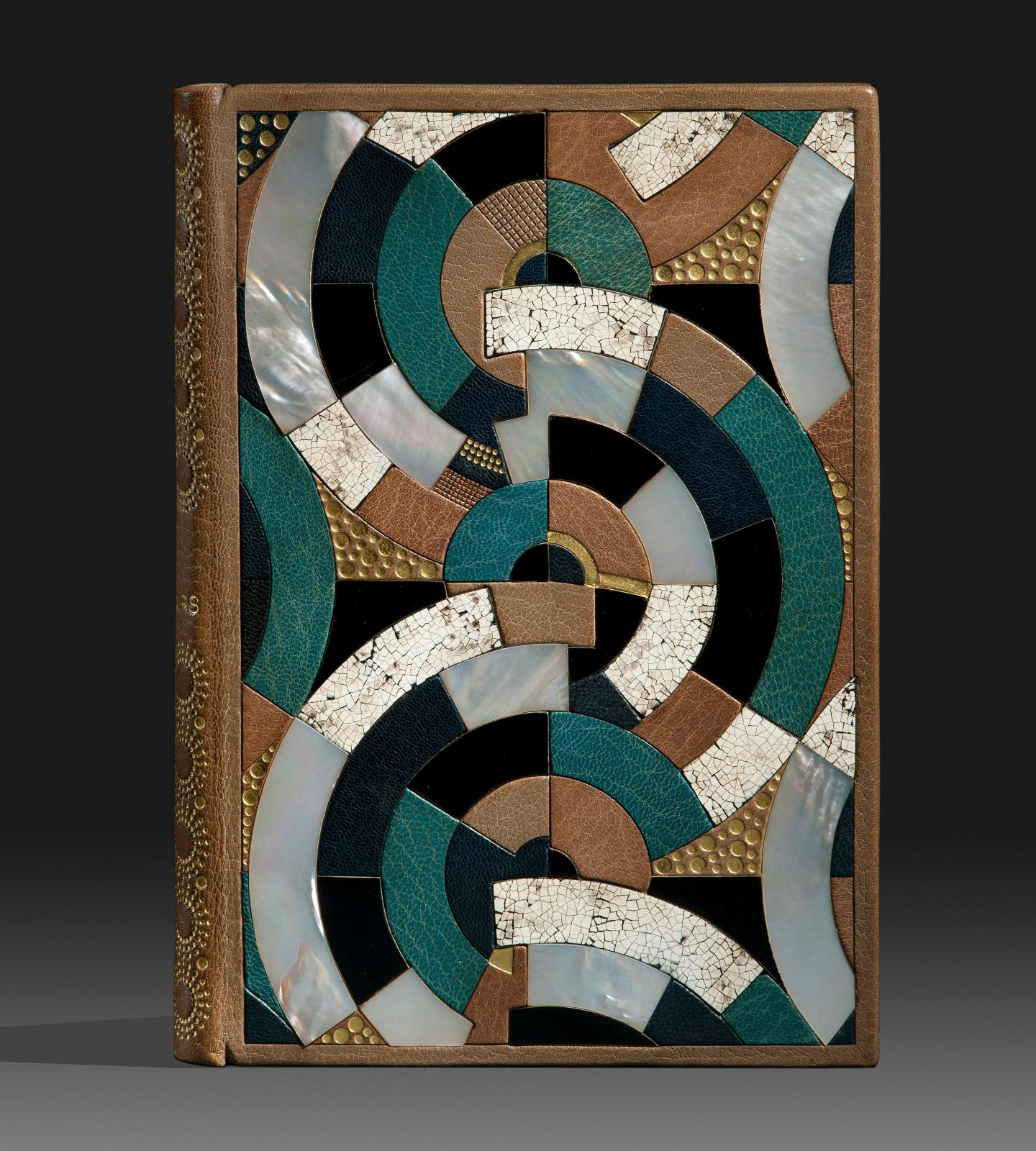 Binding for À rebours by Joris-Karl Huysmans. Covers embellished with a geometric composition in a mosaic of circle arc portions in morocc