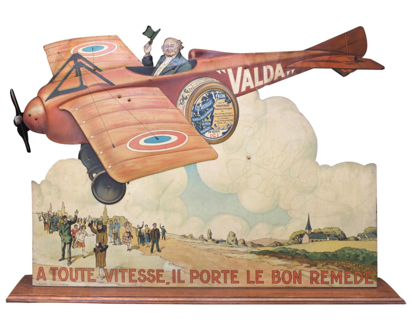 PASTILLES VALDA, Àtoute vitesse, il porte le bon remède. Scène de l'aéroplane.Automate COURTIN et impression sur métaux par l'ALUTOLParis