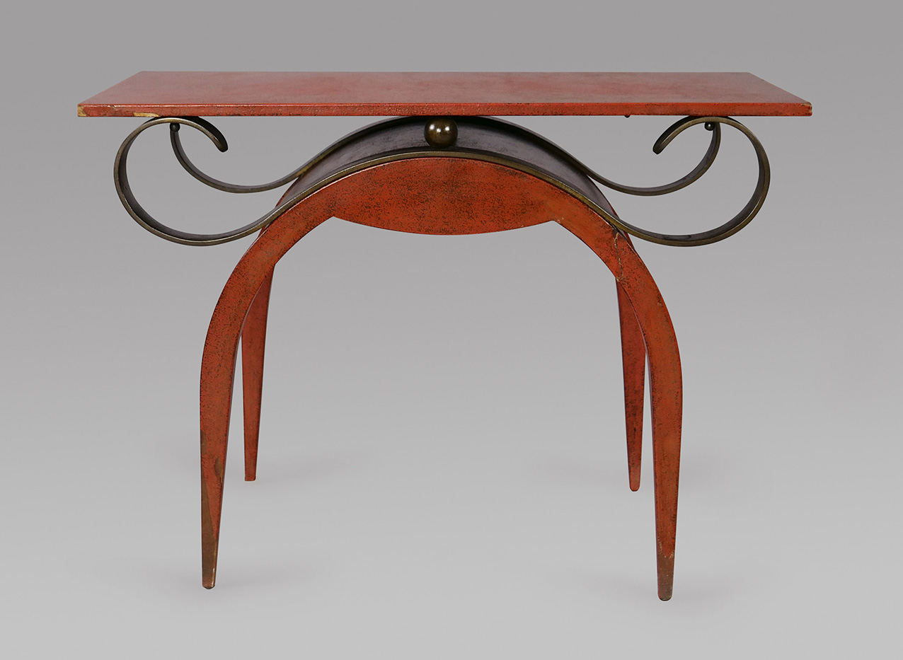 Eugène Printz (1889-1948), side table in distressed chamois red lacquer with a rectangular top, four sponge-oxidised bronze scrolls and a