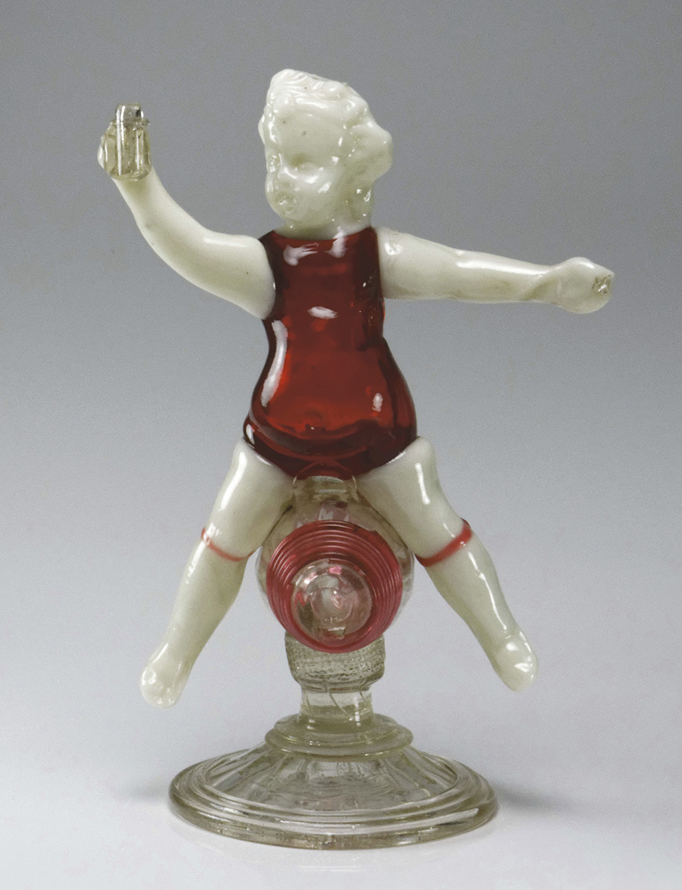 Bernard Perrot (1640-1709), Orléans, second half of the 17th century, vitro-porcelain and translucent red glass Bacchus straddling a colou