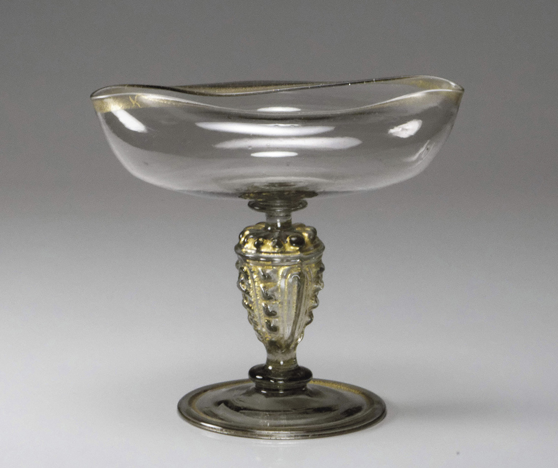 """Venice or Venetian style, late 16th century, """"magelei"""" cup with gilded rim, standing on a hollow baluster foot with gilt ladder stem mould"""