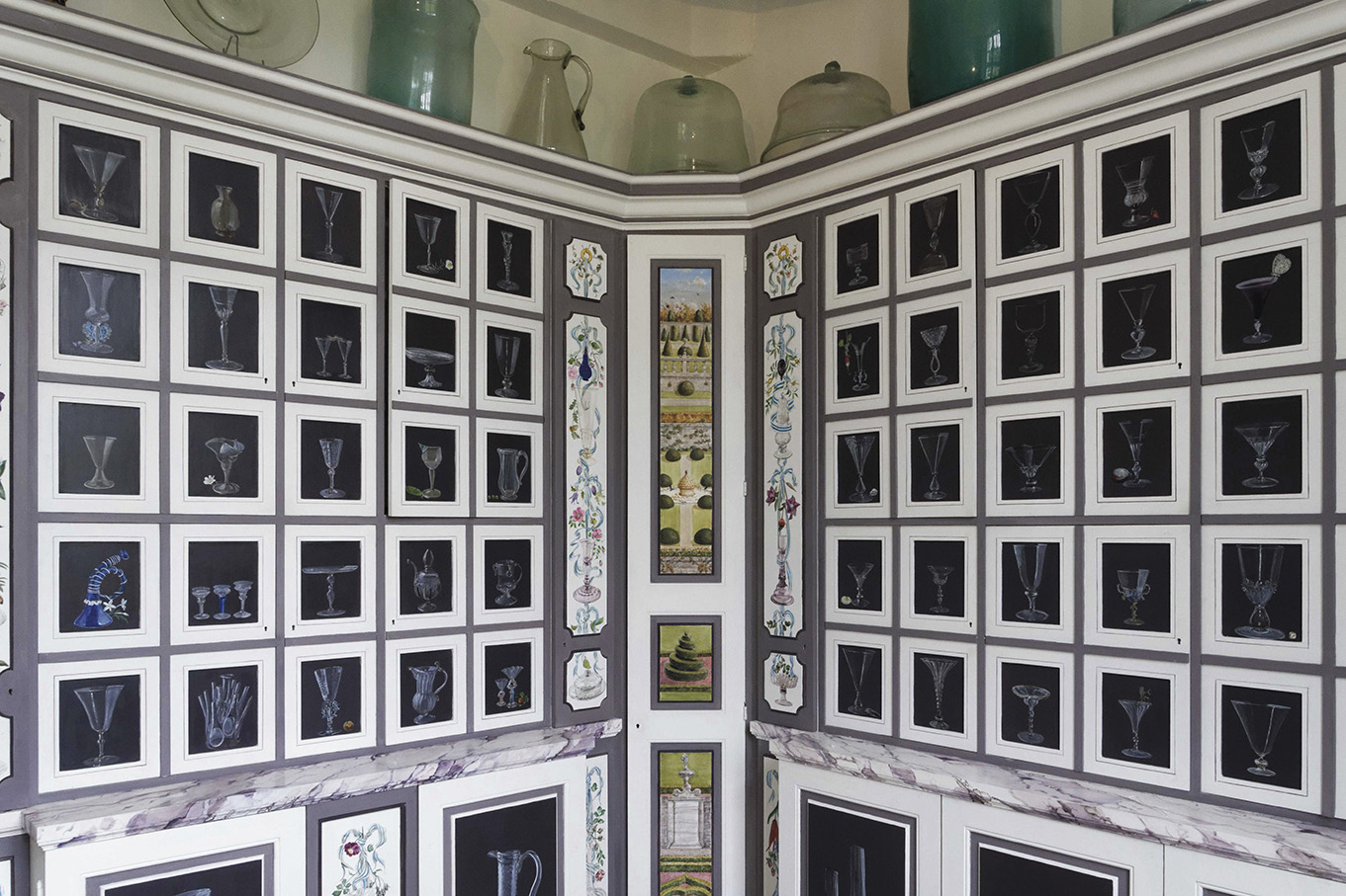 General view of the wood-panelled cabinet housing Barbara Wirth's antique glassware collection at the Château de Brécy.
