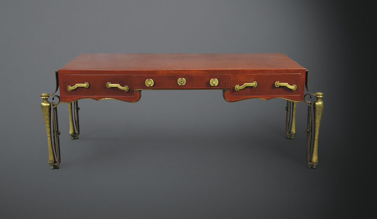 Eugène Printz (1889-1948) and Jean Dunand (1877-1942), flat desk in chamois-red lacquered wood, c. 1931, 73.5 x 196 x 67.5 cm.Result: €440