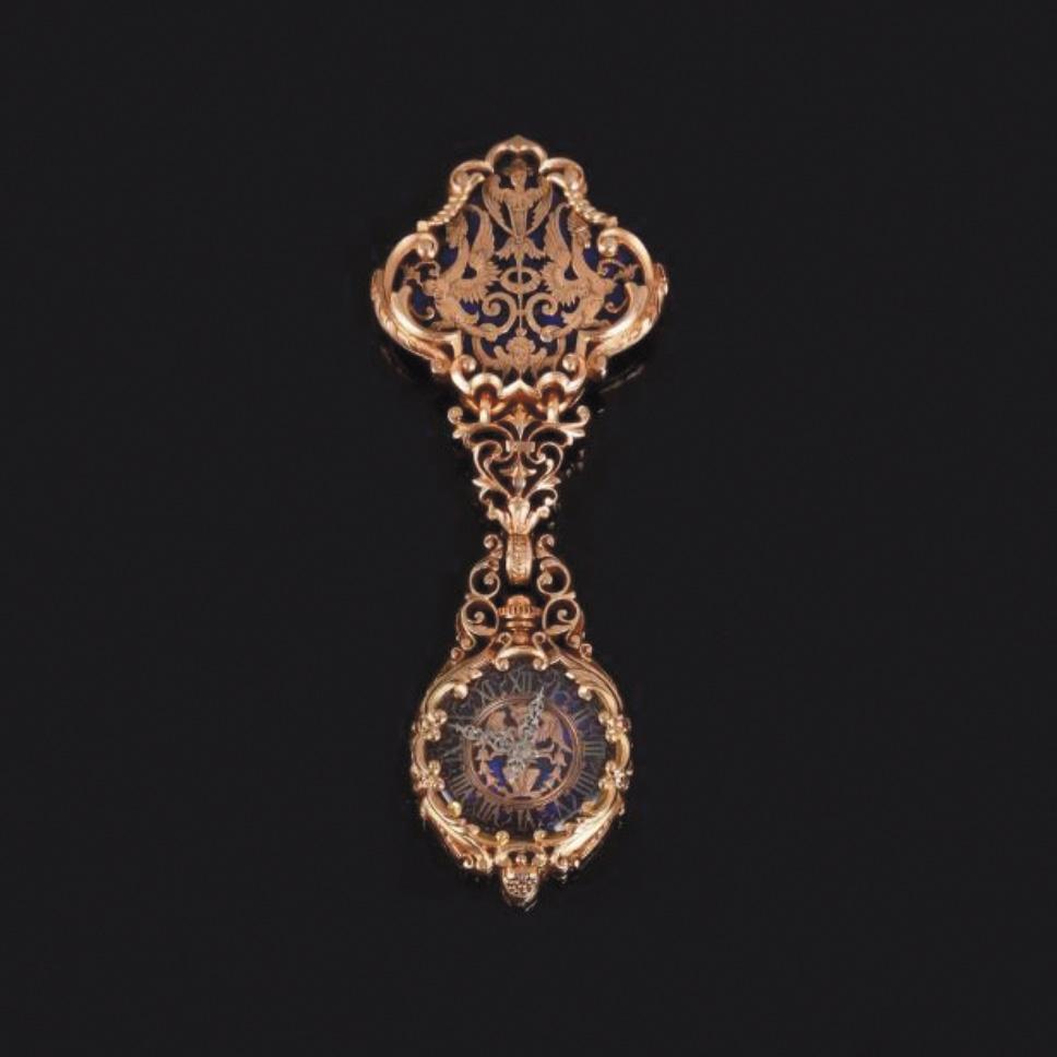 9375€ Frédéric Boucheron, seconde moitié du XIXesiècle, châtelaine en or ciselé et ajouré retenant en pendant une montre en or émaillé,