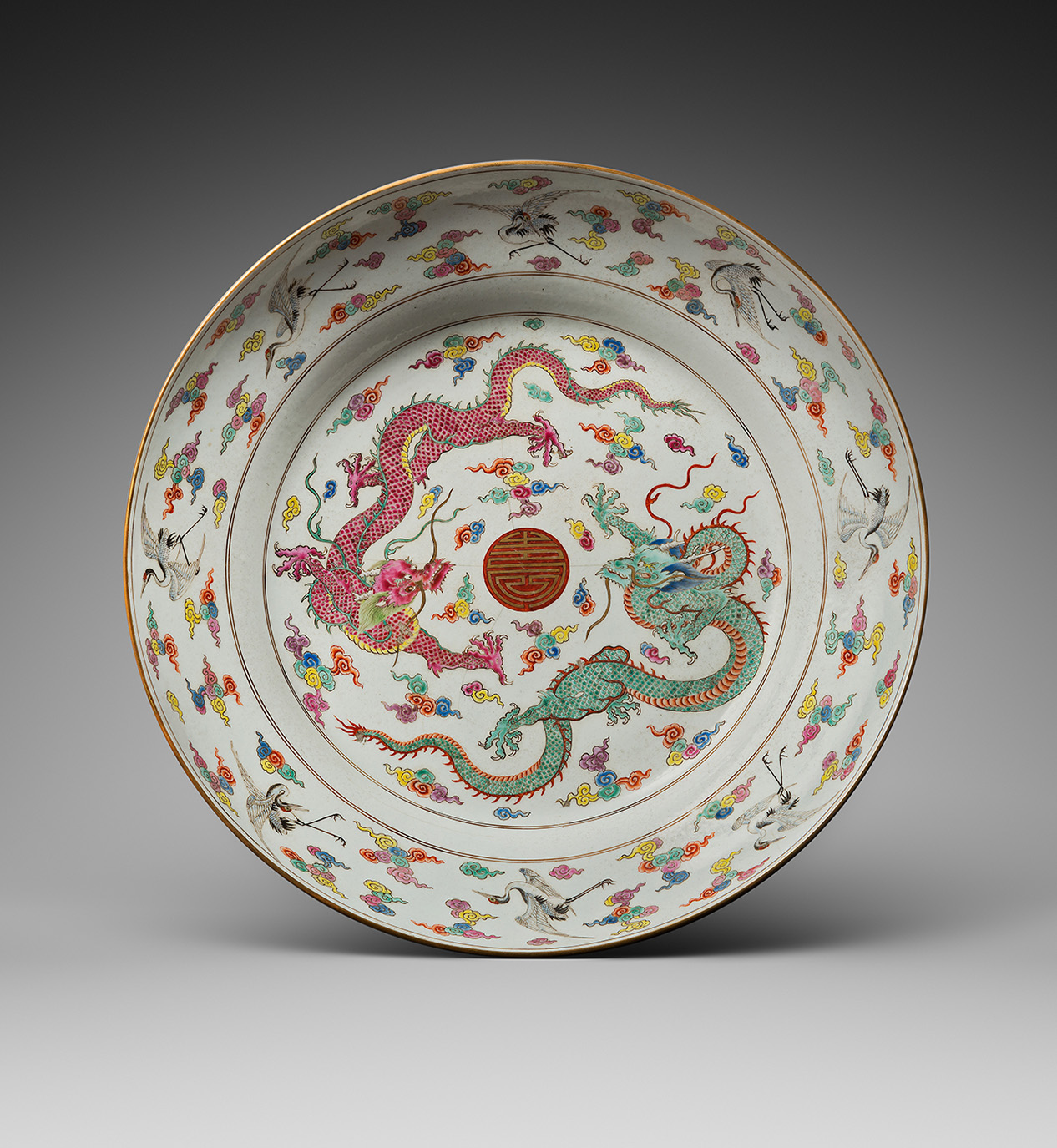 China, Yongzheng period (1723-1735), polychrome enameled porcelain cup decorated in the center with two dragons surrounding a stylized sho