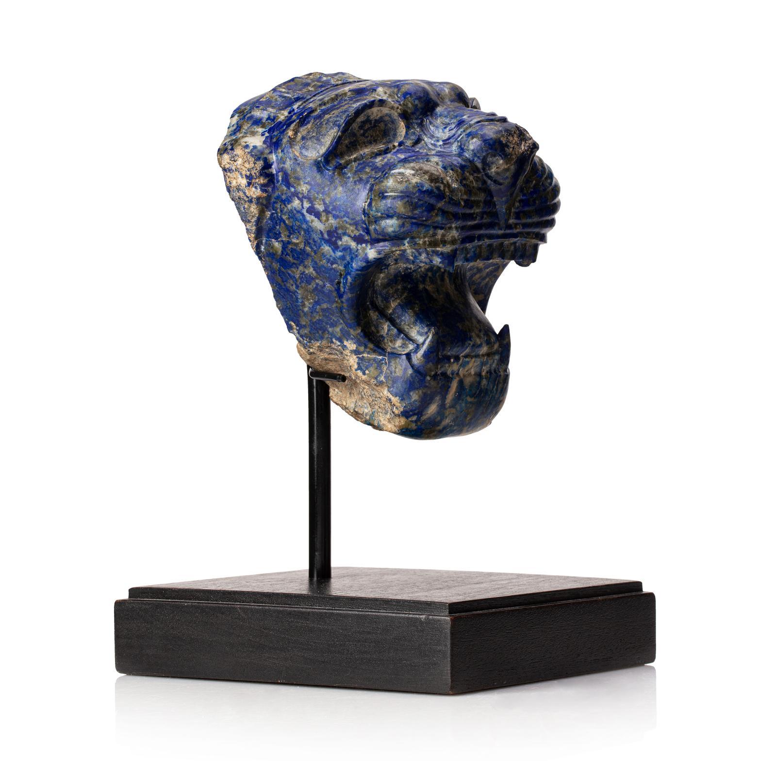 """Roaring Lion's Head, Neo-Assyrian, 9-8th centuries BCE, Lapis-lazuli, 12.5 cm (4.92 in). Exhibition: """"Trésors de l'ancien Iran"""", Rath Muse"""