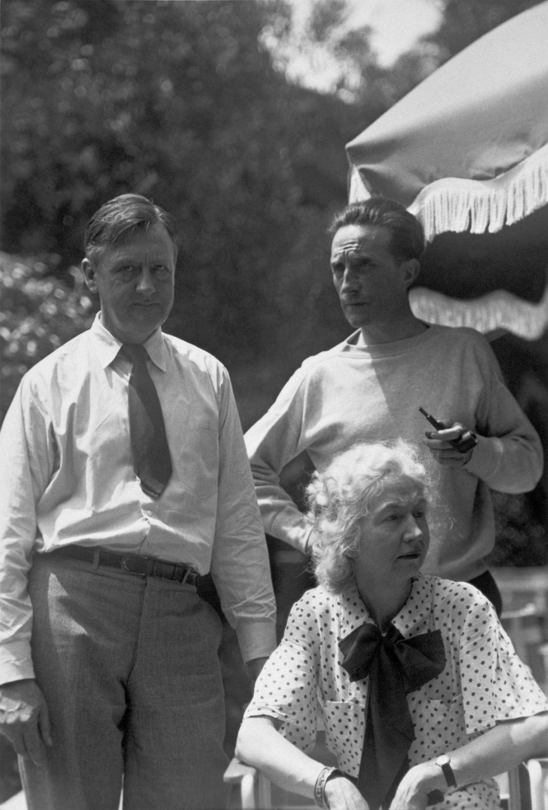 Photograph by Beatrice Wood (1893-1998), Louise Arensberg, Walter Arensberg, and Marcel Duchamp in the garden at 7065 Hillside Avenue, Los
