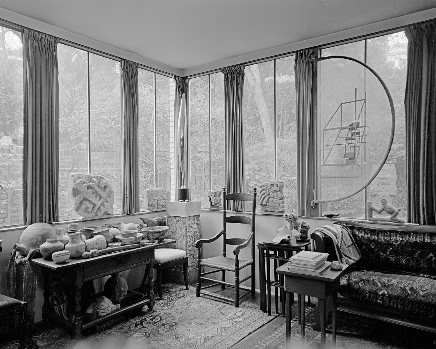 Photograph by Karl Bissinger (1914-2008). View of Louise and Walter Arensberg's sunroom at 7065 Hillside Avenue, Los Angeles, 16 March 195