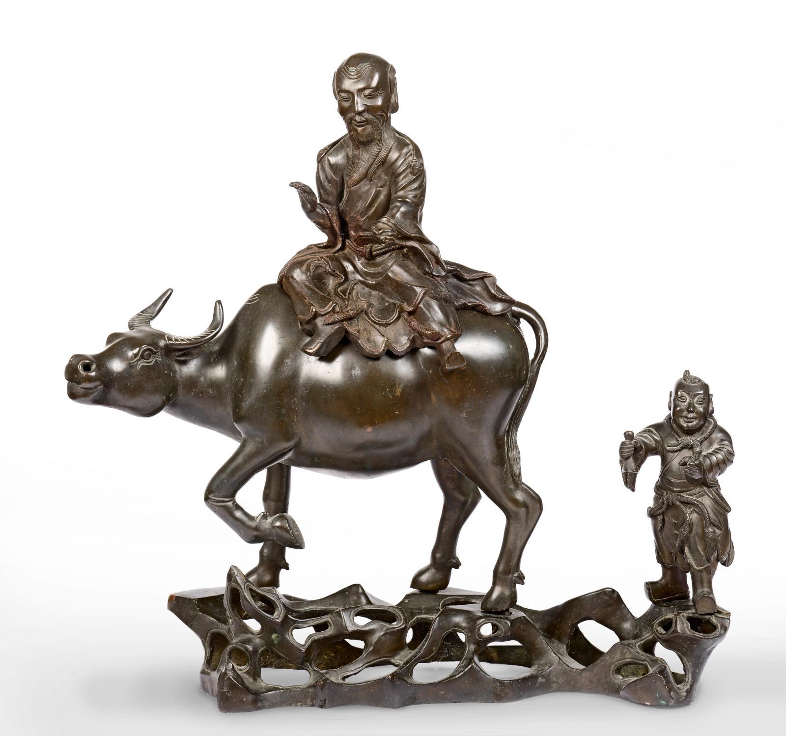 Chine, dynastie Ming, XVIIesiècle. Brûle-parfum en bronze à patine brune, fonte en quatre pièces, représentant Laozi chevauchant un buffle d'eau marc