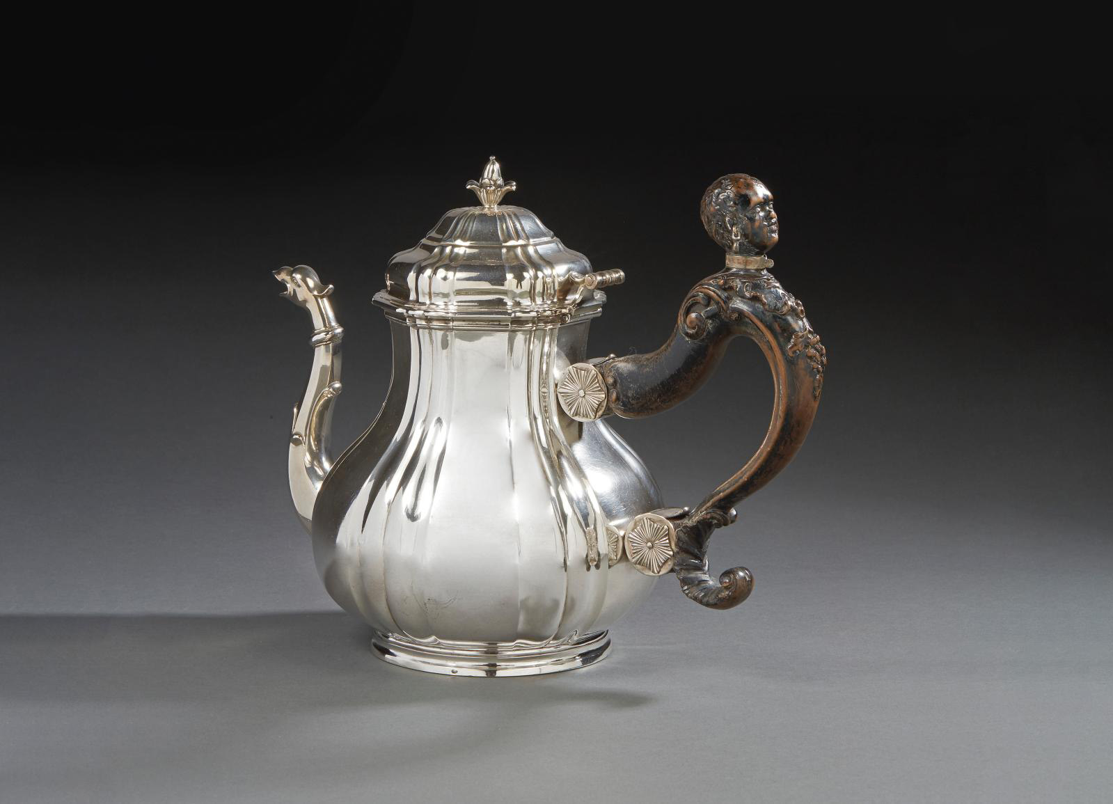 Pierre-Louis Du Floo, teapot with a decoration of plain sections and gadroons, spout ornamented with an animal head, wooden handle with ca