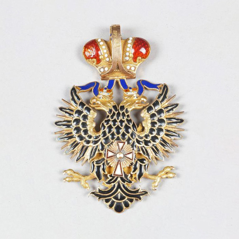 """€30,750Russia, Order of the White Eagle, gold and enamel commander's insignia, punches """"1867 (?)"""", """"RS"""" or """"KS"""" and """"56"""", h. 6.5 cm (2.56"""