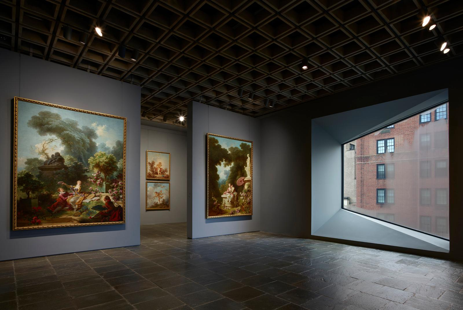 Room 24: Four grand panels of Fragonard's series The Progress of Love are shown together at Frick Madison in a gallery illuminated by one
