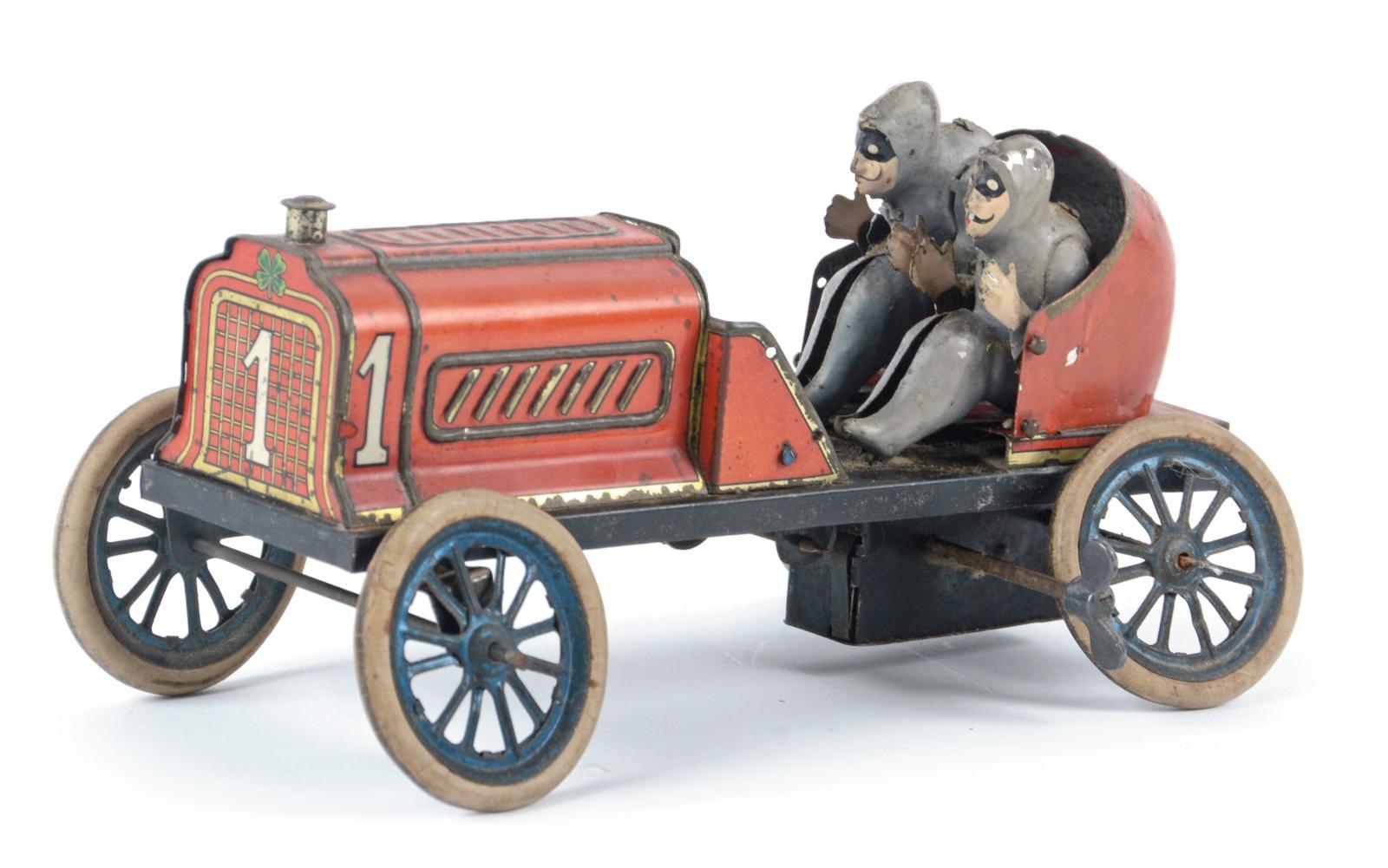 Allemagne, Fischer, début du XXesiècle. Automobile de course type «Gordon Bennett» mécanique,tôle lithographiée rouge et or, l.20,5cm.