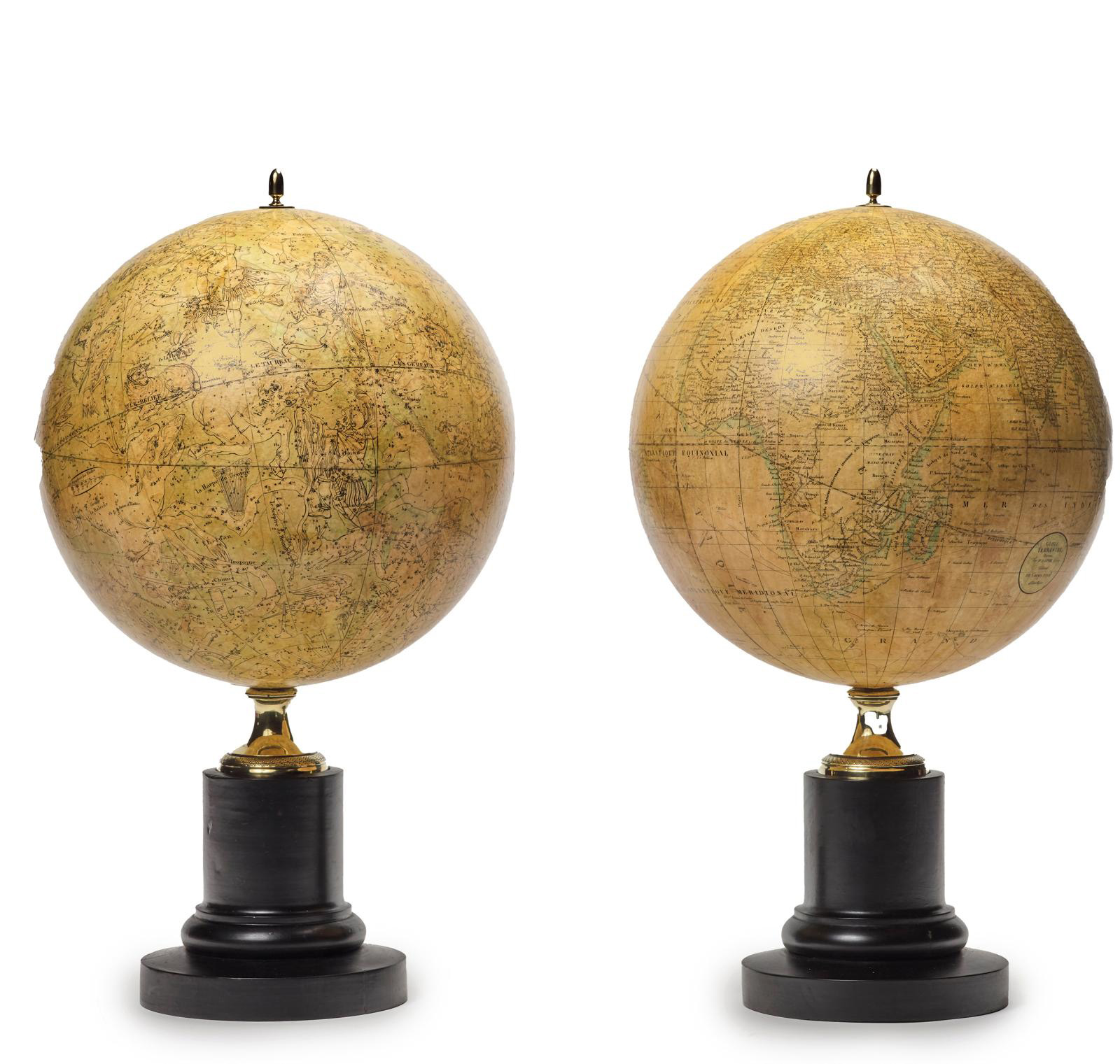 Pair of terrestrial and celestial globes by geographers P. Lapie and A. Freimin, Paris, edited by Bastien the Elder, standing on a darkene