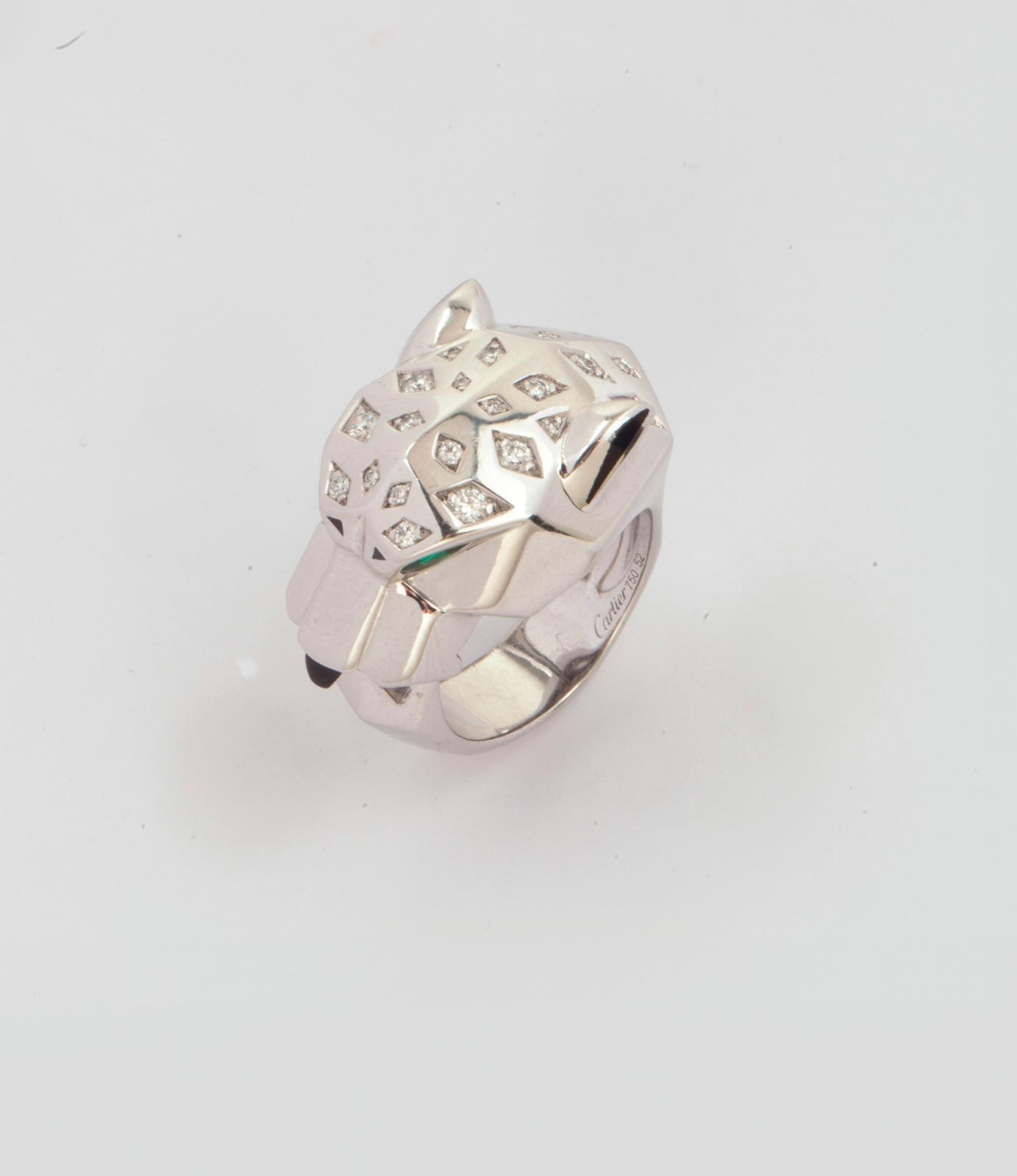 €12,544Cartier, white gold ring based on the panther motif created under Jeanne Toussaint (1887-1976), featuring a panther's head, diamond