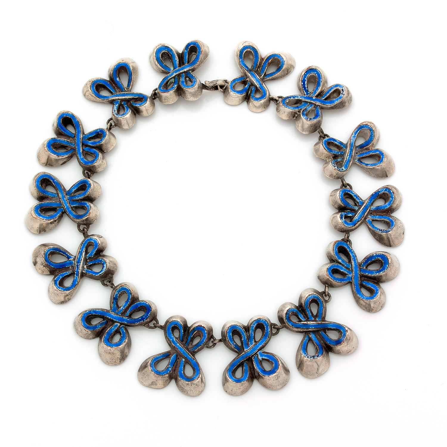 €1,560Line Vautrin (1913-1977), Nœuds necklace in silver-plated bronze and blue enamel with the monogram LV, c. 1940Paris, November 24, 20