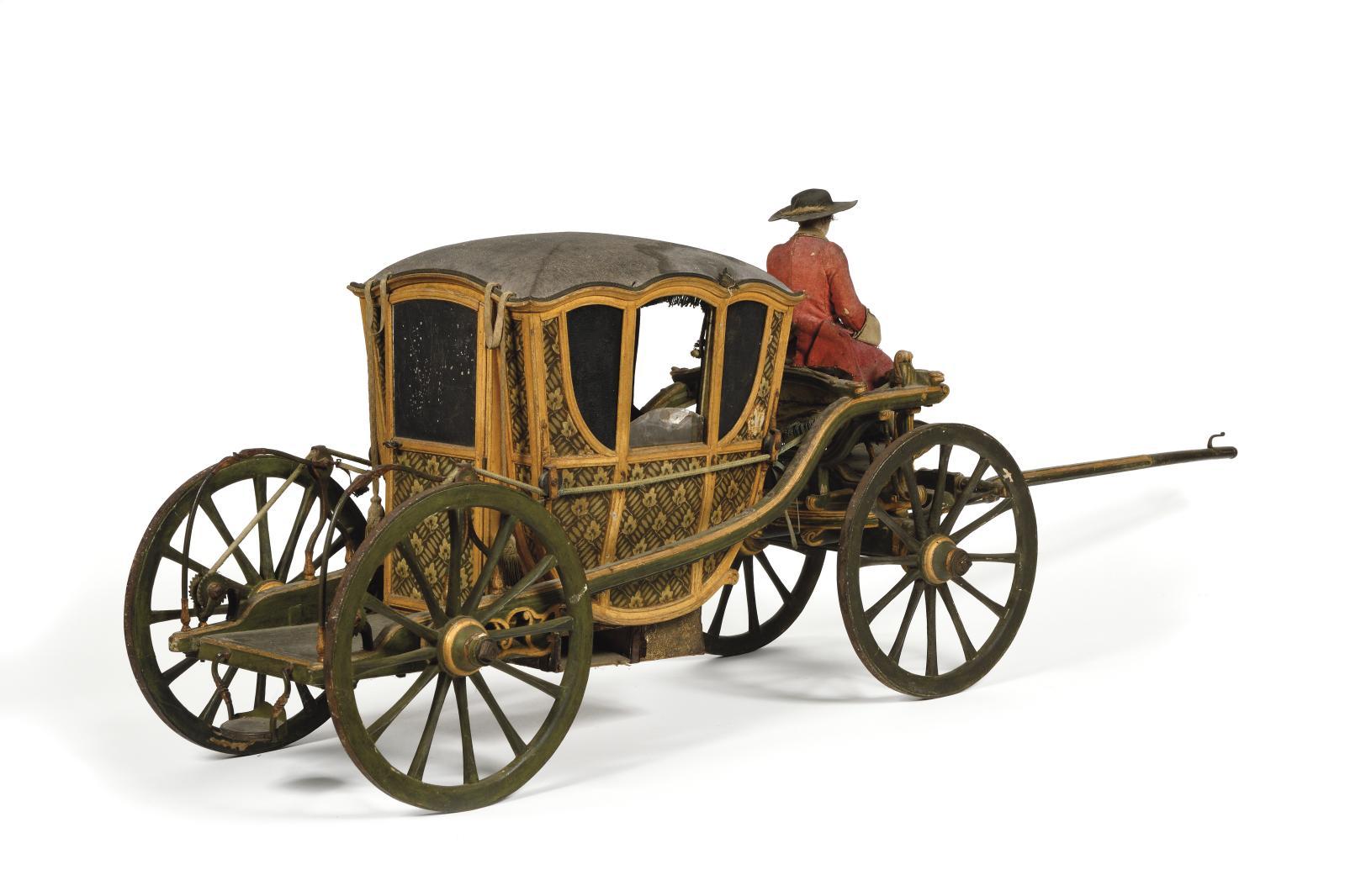 Fin du XVIIe ou début du XVIIIesiècle. Berline, châssis en fer et bois sculpté et peint, système de suspension par cordes à boyau relié a