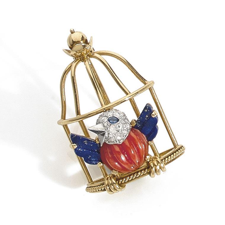25502€ Cartier, d'après l'«Oiseau en cage» de Jeanne Toussaint (1942), broche «L'Oiseau libéré», 1944,or jaune 18ct, lapis-lazuli, cora